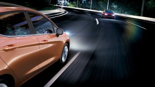 Next Generation Ford Fiesta exterior rear angle, on the road in the night